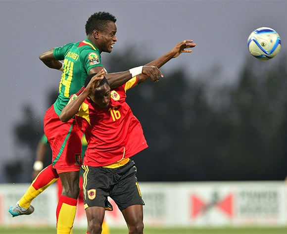 Alexandre Kombi of Cameroon wins header against Moco of Angola during the 2016 CHAN football match between Angola and Cameroon at the Huye Stadium in Butare, Rwanda on 17 January 2016 ©Gavin Barker/BackpagePix
