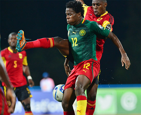 Samuel Nlend of Cameroon challenged by Fabricio of Angola