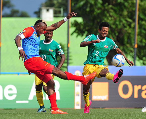 Joel Kimwaki of DR Congo clears the ball Tekalin Dejene of Ethiopia during the 2016 CHAN Rwanda, match between DR Congo and Ethiopia at the Huye Stadium in Butare, Rwanda on 17 January 2016 ©Muzi Ntombela/BackpagePix