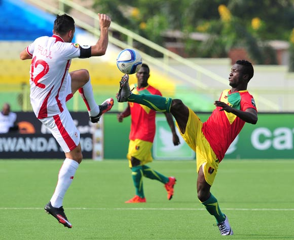 Daouda Camara of Guinea challenged by Ali Maaloul of Tunisia during the 2016 CHAN Rwanda, match between Tunisia and Guinea at the Stade de Kigali in Kigali, Rwanda on 18 January 2016 ©Muzi Ntombela/BackpagePix