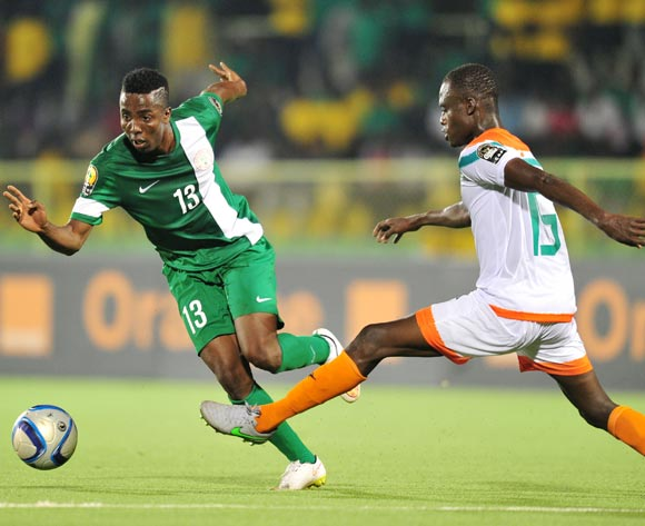 Chisom Chikatara of Nigeria challenged by Katkore Boureima of Niger during the 2016 CHAN Rwanda, match between Nigeria and Niger at the Stade de Kigali in Kigali, Rwanda on 18 January 2016 ©Muzi Ntombela/BackpagePix