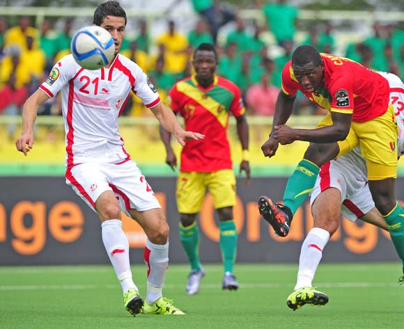 Alseny Camara of Guinea shoots at goal as Zied Derbali of Tunisia looks on during the 2016 CHAN Rwanda game between Tunisia and Guinea at Stade de Kigali Stadium, Kigali on 18 January 2016 ©Ryan Wilkisky/BackpagePix
