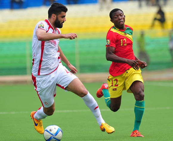 Aboubacar Sylla of Guinea takes on Zied Boughattas of Tunisia during the 2016 CHAN Rwanda game between Tunisia and Guinea at Stade de Kigali Stadium, Kigali on 18 January 2016 ©Ryan Wilkisky/BackpagePix