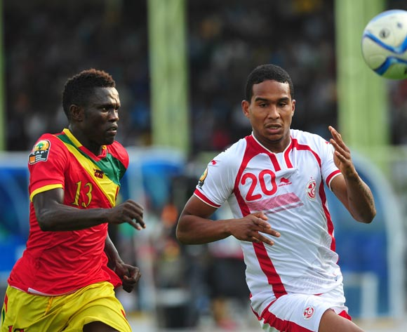 Seifeddin Jaziri of Tunisia gets to the ball ahead of Alsény Camara of Guinea during the 2016 CHAN Rwanda game between Tunisia and Guinea at Stade de Kigali Stadium, Kigali on 18 January 2016 ©Ryan Wilkisky/BackpagePix