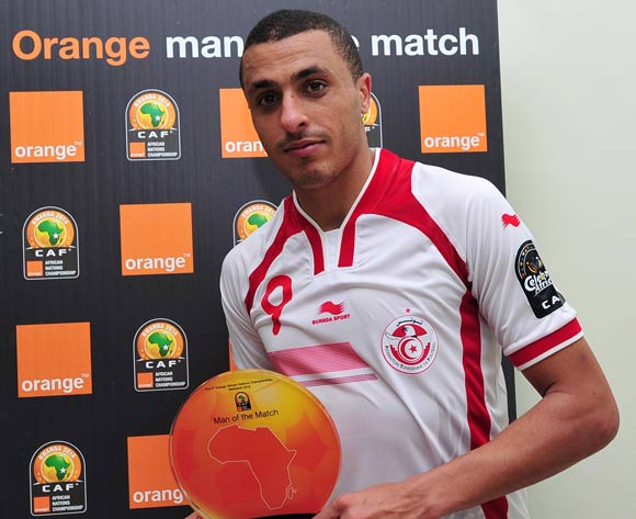 Ahmed Akaichi of Tunisia receives his 'Orange Man of the Match' award after the 2016 CHAN Rwanda game between Tunisia and Guinea at Stade de Kigali Stadium, Kigali on 18 January 2016 ©Ryan Wilkisky/BackpagePix