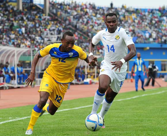 Jean Claude Iranzi of Rwanda tackled by Cyrille Engozo Avebe of Gabon  during the 2016 CHAN Rwanda, match between Rwanda and Gabon at the Amahoro Stadium in Kigali, Rwanda on 20 January 2016 ©Muzi Ntombela/BackpagePix