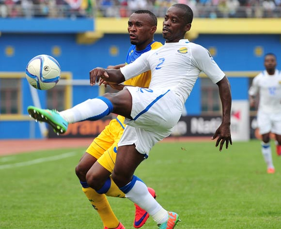 Georges Ambourouet of Gabon clears the ball from Jacques Tuyisenge of Rwanda  during the 2016 CHAN Rwanda, match between Rwanda and Gabon at the Amahoro Stadium in Kigali, Rwanda on 20 January 2016 ©Muzi Ntombela/BackpagePix