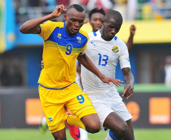 Jacques Tuyisenge of Rwanda challenged by Franck Perrin Obambou of Gabon