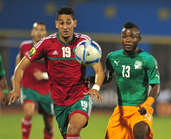 Yao Serge Nguessan of Ivory Coast challenged by Mourad Batna of Morocco  during the 2016 CHAN Rwanda, match between Morocco and Ivory Coast at the Amahoro Stadium in Kigali, Rwanda on 20 January 2016 ©Muzi Ntombela/BackpagePix