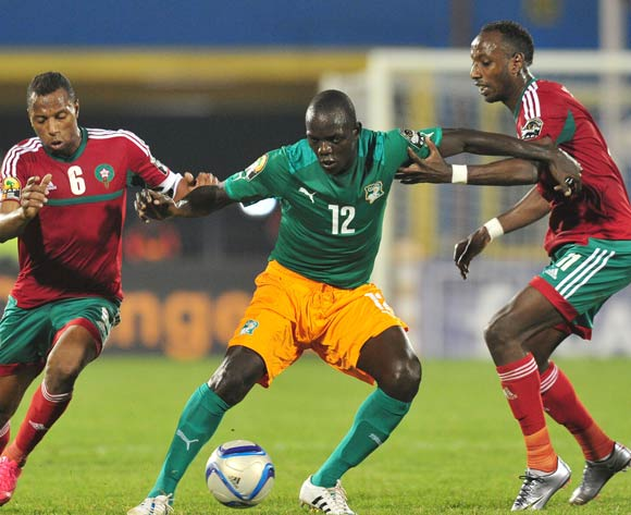 Okpekon Marius Yace of Ivory Coast battles with Abdeladim Khadrouf and Brahim Nekkach of Morocco  during the 2016 CHAN Rwanda, match between Morocco and Ivory Coast at the Amahoro Stadium in Kigali, Rwanda on 20 January 2016 ©Muzi Ntombela/BackpagePix