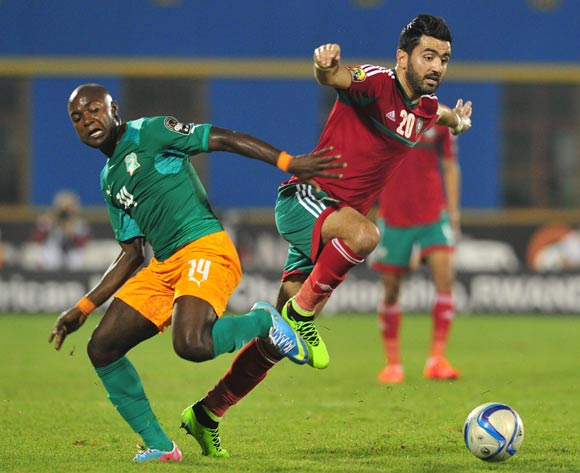 Ahmed Jahouh of Morocco battles with Franck Djedje Guiza of Ivory Coast  during the 2016 CHAN Rwanda, match between Morocco and Ivory Coast at the Amahoro Stadium in Kigali, Rwanda on 20 January 2016 ©Muzi Ntombela/BackpagePix