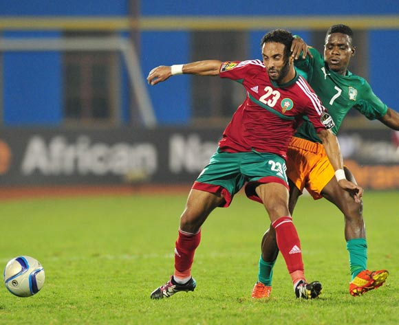 Issam Erraki  of Morocco challenged by Djobo Atcho of Ivory Coast  during the 2016 CHAN Rwanda, match between Morocco and Ivory Coast at the Amahoro Stadium in Kigali, Rwanda on 20 January 2016 ©Muzi Ntombela/BackpagePix