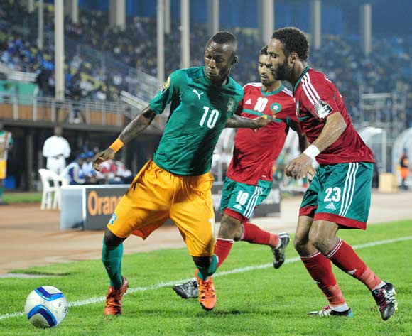 Krahire Yannick Zakri of Ivory Coast challenged by Issam Erraki  of Morocco  during the 2016 CHAN Rwanda, match between Morocco and Ivory Coast at the Amahoro Stadium in Kigali, Rwanda on 20 January 2016 ©Muzi Ntombela/BackpagePix