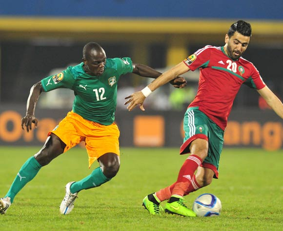 Ahmed Jahouh of Morocco challenged by Okpekon Marius Yace of Ivory Coast  during the 2016 CHAN Rwanda, match between Morocco and Ivory Coast at the Amahoro Stadium in Kigali, Rwanda on 20 January 2016 ©Muzi Ntombela/BackpagePix