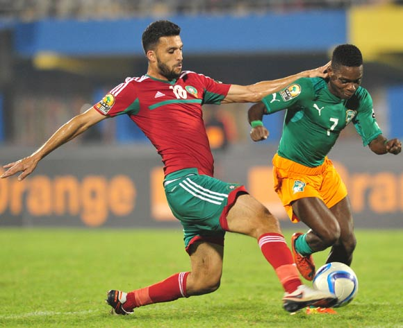 Djobo Atcho of Ivory Coast tackled by Mohamed Oulhaj of Morocco during the 2016 CHAN Rwanda, match between Morocco and Ivory Coast at the Amahoro Stadium in Kigali, Rwanda on 20 January 2016 ©Muzi Ntombela/BackpagePix