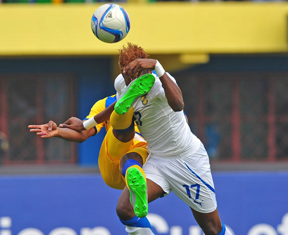 Aaron Salem Boupendza of Gabon is fouled by Abdul Rwatubyaye of Rwanda during the 2016 CHAN football match between Rwanda and Gabon at the Amahora Stadium in Kigali, Rwanda on 20 January 2016 ©Ryan Wilkisky/BackpagePix