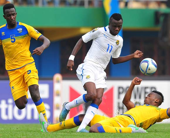 Abdul Rwatubyaye of Rwanda makes a tackle on Mario Bernard Mandrault of Gabon during the 2016 CHAN football match between Rwanda and Gabon at the Amahora Stadium in Kigali, Rwanda on 20 January 2016 ©Ryan Wilkisky/BackpagePix