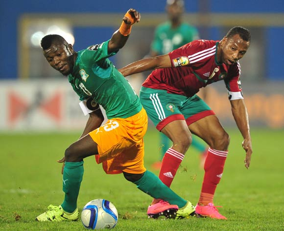 Yao Serge Nguessan of Ivory Coast and Brahim Nakach of Morocco battle for possession during the 2016 CHAN football match between Morocco and Ivory Coast at the Amahora Stadium in Kigali, Rwanda on 20 January 2016 ©Ryan Wilkisky/BackpagePix