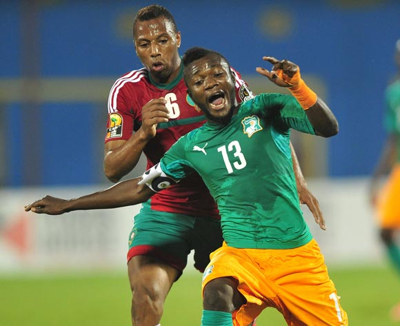Yao Serge Nguessan of Ivory Coast and Brahim Nakach of Morocco battle for possession