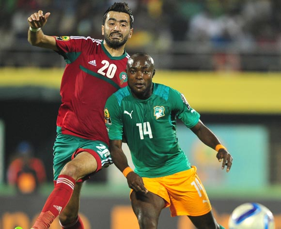 Franck Djedje Guiza of Ivory Coast gets his pass away as Ahmed Jahouh of Morocco makes the tackle during the 2016 CHAN football match between Morocco and Ivory Coast at the Amahora Stadium in Kigali, Rwanda on 20 January 2016 ©Ryan Wilkisky/BackpagePix