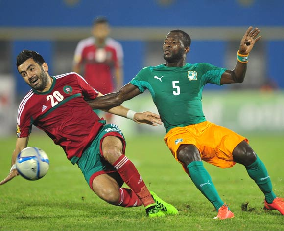 Ahmed Jahouh of Morocco and Beaudelaire Aka Essis of Ivory Coast battle for possession during the 2016 CHAN football match between Morocco and Ivory Coast at the Amahora Stadium in Kigali, Rwanda on 20 January 2016 ©Ryan Wilkisky/BackpagePix