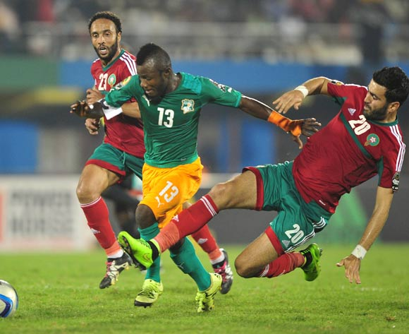 Ahmed Jahouh of Morocco makes a last ditch tackle on Yao Serge Nguessan of Ivory Coast during the 2016 CHAN football match between Morocco and Ivory Coast at the Amahora Stadium in Kigali, Rwanda on 20 January 2016 ©Ryan Wilkisky/BackpagePix