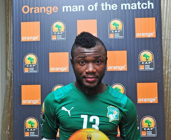 Yao Serge Nguessan of Ivory Coast receives the 'Orange Man of the Match' award after the 2016 CHAN football match between Morocco and Ivory Coast at the Amahora Stadium in Kigali, Rwanda on 20 January 2016 ©Ryan Wilkisky/BackpagePix