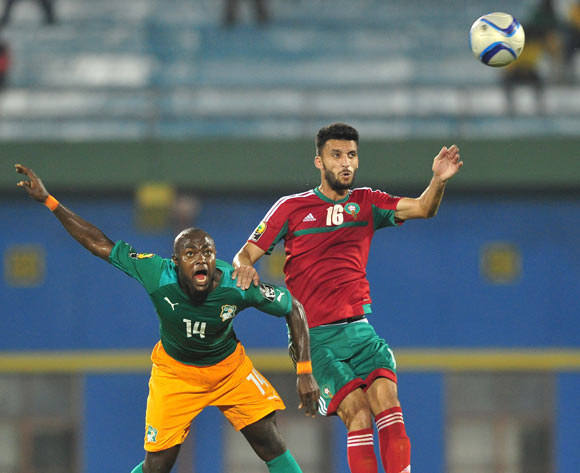 Franck Djedje Guiza of Ivory Coast  and Mohamed Oulhaj of Morocco battle in the air during the 2016 CHAN football match between Morocco and Ivory Coast at the Amahora Stadium in Kigali, Rwanda on 20 January 2016 ©Ryan Wilkisky/BackpagePix