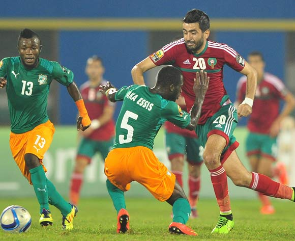 Ahmed Jahouh of Morocco takes on Beaudelaire Aka Essis of Ivory Coast during the 2016 CHAN football match between Morocco and Ivory Coast at the Amahora Stadium in Kigali, Rwanda on 20 January 2016 ©Ryan Wilkisky/BackpagePix
