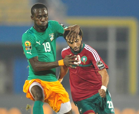 Nilmar Ble Treika of Ivory Coast holds on to Issam Erraki  of Morocco during the 2016 CHAN football match between Morocco and Ivory Coast at the Amahora Stadium in Kigali, Rwanda on 20 January 2016 ©Ryan Wilkisky/BackpagePix
