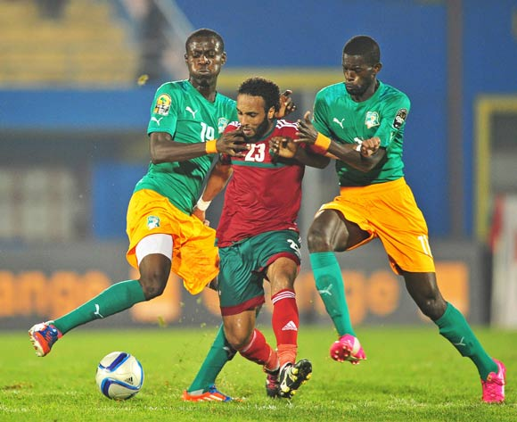 Issam Erraki  of Morocco  is fouled by Nilmar Ble Treika and Davy Koffi Boua of Ivory Coast during the 2016 CHAN football match between Morocco and Ivory Coast at the Amahora Stadium in Kigali, Rwanda on 20 January 2016 ©Ryan Wilkisky/BackpagePix