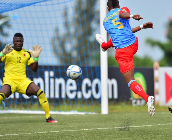 Meschack Elia of DR Congo scores past Mavanga Landu of Angola during the 2016 CHAN football match between DR Congo and Angola at the Huye Stadium in Butare, Rwanda on 21 January 2016 ©Gavin Barker/BackpagePix