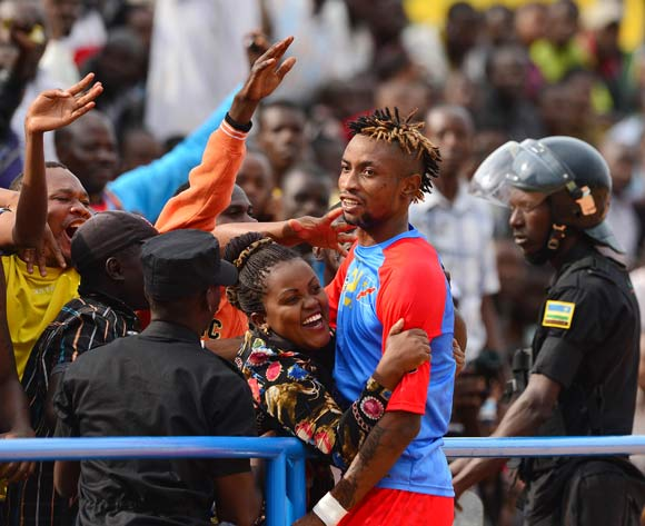Jonathan Bolingi of DR Congo celebrates goal  with fans during the 2016 CHAN football match between DR Congo and Angola at the Huye Stadium in Butare, Rwanda on 21 January 2016 ©Gavin Barker/BackpagePix
