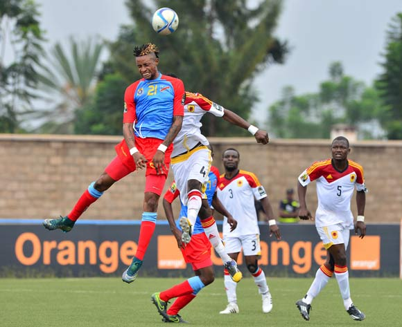 Jonathan Bolingi of DR Congo wins header against Fabricio Mafuta of Angola during the 2016 CHAN football match between DR Congo and Angola at the Huye Stadium in Butare, Rwanda on 21 January 2016 ©Gavin Barker/BackpagePix