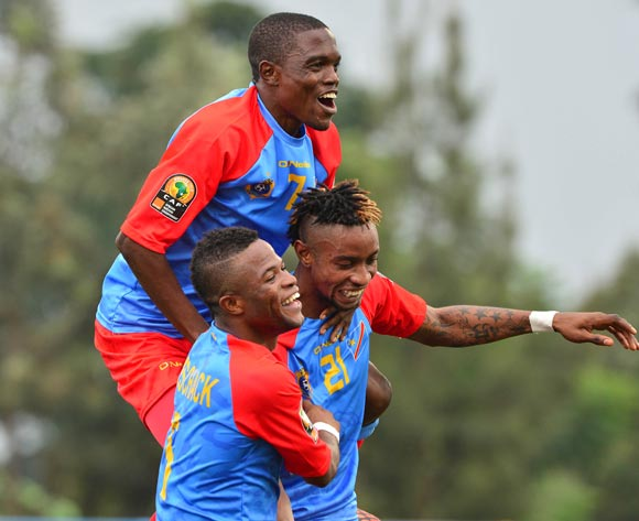 Doxa Gikanji (top), Jonathan Bolingi (r) and Meschack Elia of DR Congo (l) celebrates win during the 2016 CHAN football match between DR Congo and Angola at the Huye Stadium in Butare, Rwanda on 21 January 2016 ©Gavin Barker/BackpagePix
