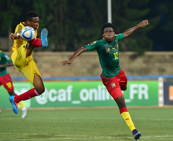 Yared Belay of Ethiopia clears ball from  Samuel Nlend of Cameroon during the 2016 CHAN football match between Cameroon and Ethiopia at the Huye Stadium in Butare, Rwanda on 21 January 2016 ©Gavin Barker/BackpagePix