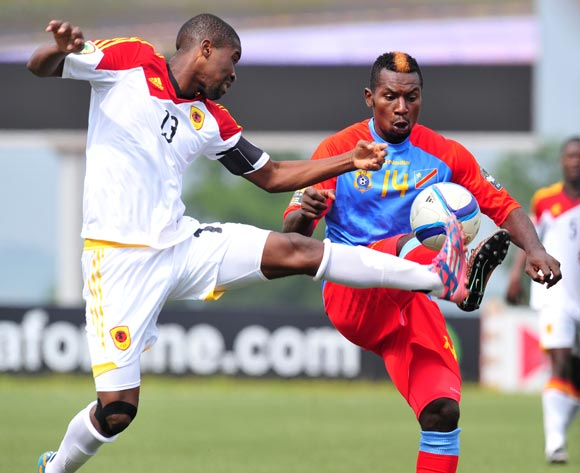 Nelson Munganga of DR Congo battles with Manucho Dinis of Angola during the 2016 CHAN Rwanda, match between DR Congo and Angola at the Huye Stadium in Butare, Rwanda on 21 January 2016 ©Muzi Ntombela/BackpagePix