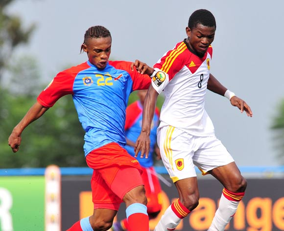 Jacinto Gelson of Angola challenged by Yannick Bangala of DR Congo  during the 2016 CHAN Rwanda, match between DR Congo and Angola at the Huye Stadium in Butare, Rwanda on 21 January 2016 ©Muzi Ntombela/BackpagePix