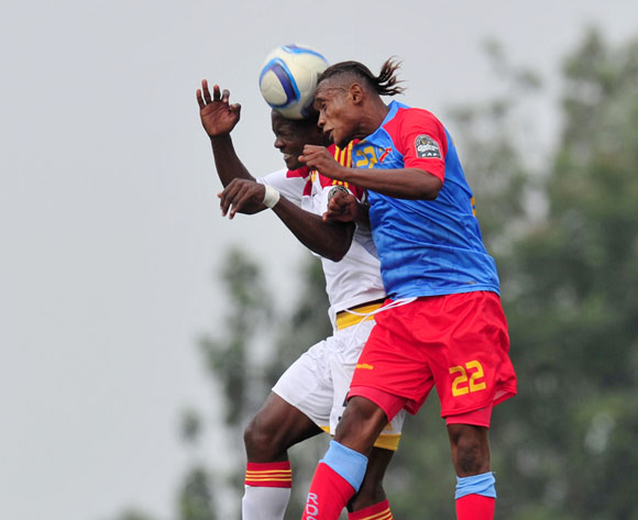 Yannick Bangala of DR Congo battles with Gomito Fonseca of Angola during the 2016 CHAN Rwanda, match between DR Congo and Angola at the Huye Stadium in Butare, Rwanda on 21 January 2016 ©Muzi Ntombela/BackpagePix