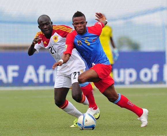 Meschak Elia of DR Congo challenged by Isaac da Costa of Angola during the 2016 CHAN Rwanda
