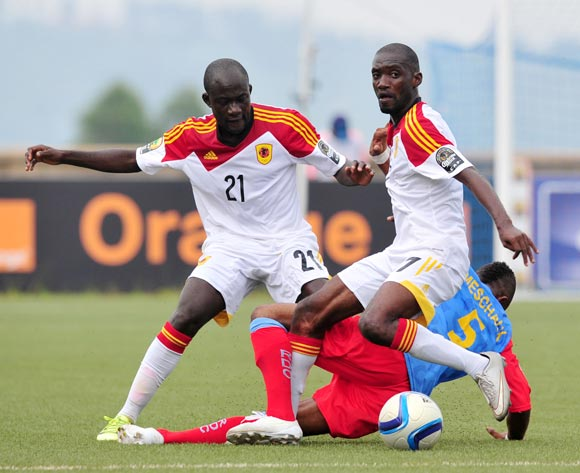 Meschak Elia of DR Congo fouled by Isaac da Costa and Petro Bua of Angola during the 2016 CHAN Rwanda, match between DR Congo and Angola at the Huye Stadium in Butare, Rwanda on 21 January 2016 ©Muzi Ntombela/BackpagePix