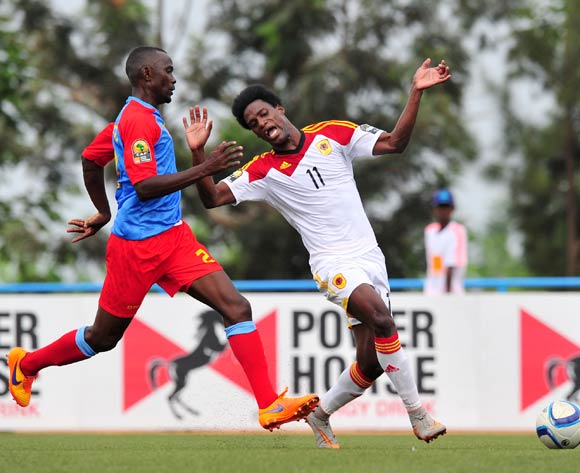 Yannick Bangala of DR Congo challenged by Adriano Yano of Angola during the 2016 CHAN Rwanda, match between DR Congo and Angola at the Huye Stadium in Butare, Rwanda on 21 January 2016 ©Muzi Ntombela/BackpagePix