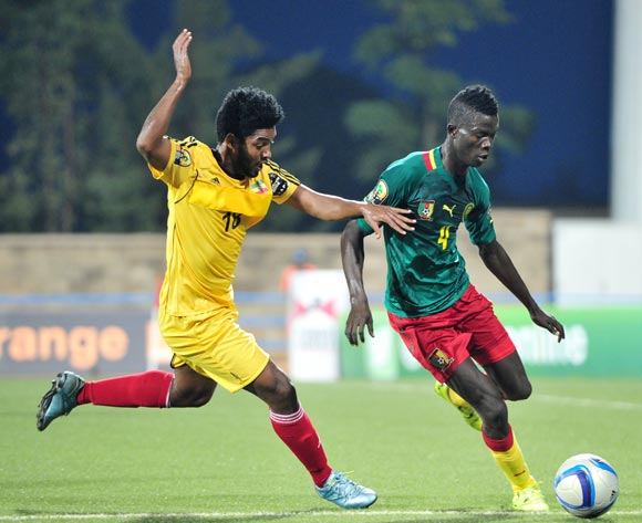 Mohammed Djetei of Cameroon challenged by Mulualem Haile of Ethiopia during the 2016 CHAN Rwanda, match between Cameroon and Ethiopia at the Huye Stadium in Butare, Rwanda on 21 January 2016 ©Muzi Ntombela/BackpagePix