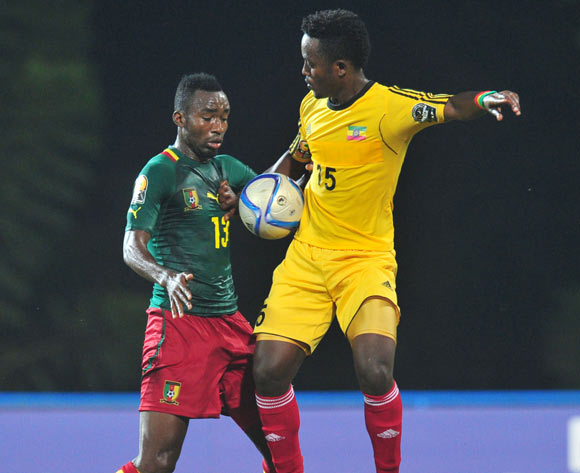 Asechalew Tamene of Ethiopia battles with Nicloas Brice Mouumi of Cameroon  during the 2016 CHAN Rwanda, match between Cameroon and Ethiopia at the Huye Stadium in Butare, Rwanda on 21 January 2016 ©Muzi Ntombela/BackpagePix