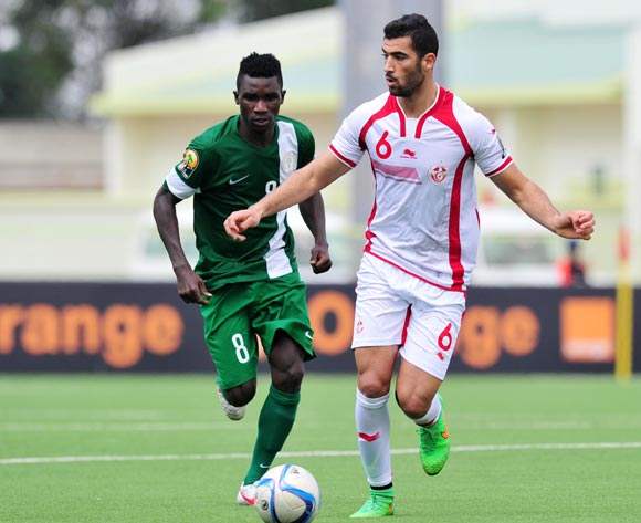 Yassine Meriah of Tunisia challenged by Matthew Ifeanyi of Nigeria  during the 2016 CHAN Rwanda, match between Tunisia and Nigeria at the Stade de Kigali in Kigali, Rwanda on 22 January 2016 ©Muzi Ntombela/BackpagePix