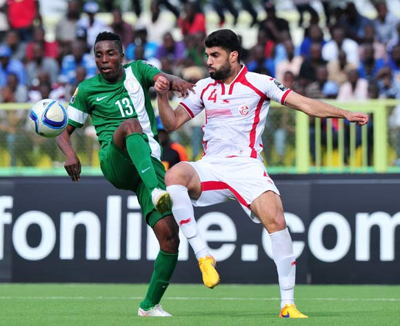 Chisom Chikatara of Nigeria battles with Zied Boughattas of Tunisia during the 2016 CHAN Rwanda, match between Tunisia and Nigeria at the Stade de Kigali in Kigali, Rwanda on 22 January 2016 ©Muzi Ntombela/BackpagePix