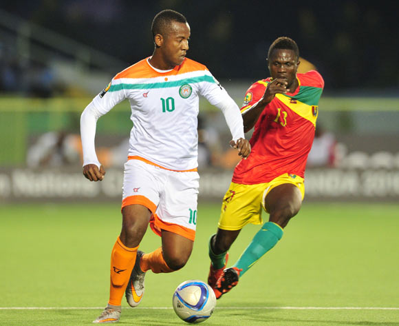 Mossi Adamou Moussa Issa of Niger challenged by Alseny Camara of Guinea  during the 2016 CHAN Rwanda, match between Niger and Guinea at the Stade de Kigali in Kigali, Rwanda on 22 January 2016 ©Muzi Ntombela/BackpagePix