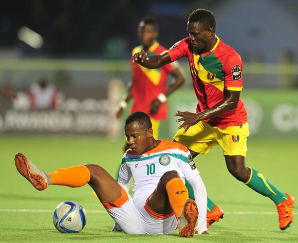 Mossi Adamou Moussa Issa of Niger fouled by Alseny Camara of Guinea  during the 2016 CHAN Rwanda, match between Niger and Guinea at the Stade de Kigali in Kigali, Rwanda on 22 January 2016 ©Muzi Ntombela/BackpagePix