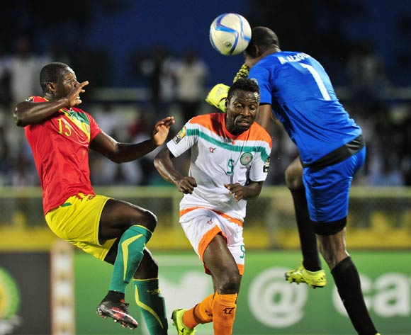 Moussa Alzouma of Niger clears ball from Alseny Camara of Guinea  during the 2016 CHAN Rwanda, match between Niger and Guinea at the Stade de Kigali in Kigali, Rwanda on 22 January 2016 ©Muzi Ntombela/BackpagePix