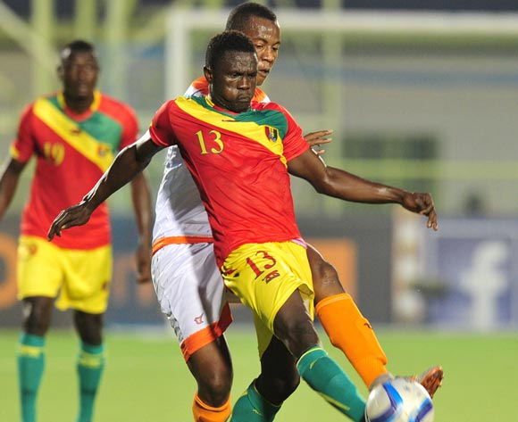 Alsény Camara of Guinea challenged by Mossi Adamou Moussa Issa of Niger during the 2016 CHAN Rwanda, match between Niger and Guinea at the Stade de Kigali in Kigali, Rwanda on 22 January 2016 ©Muzi Ntombela/BackpagePix
